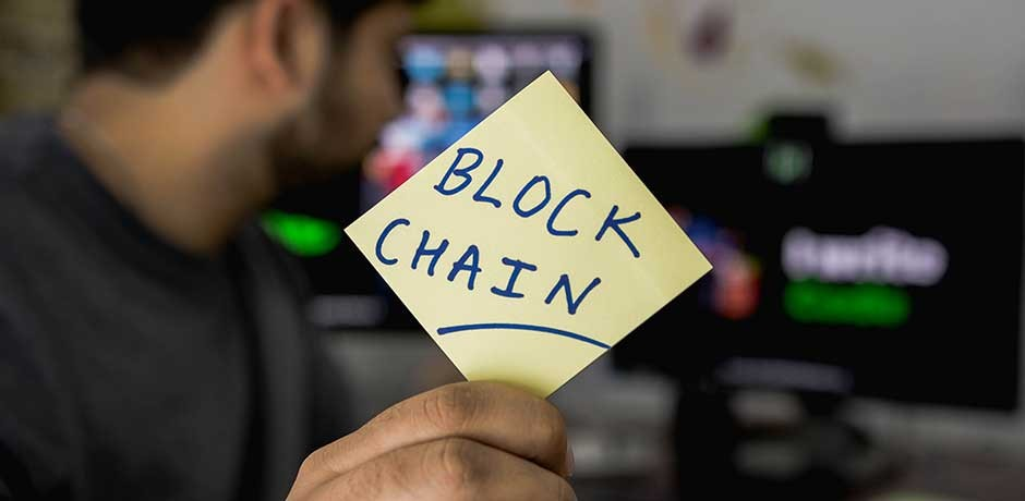 Post it with Blockchain lettering