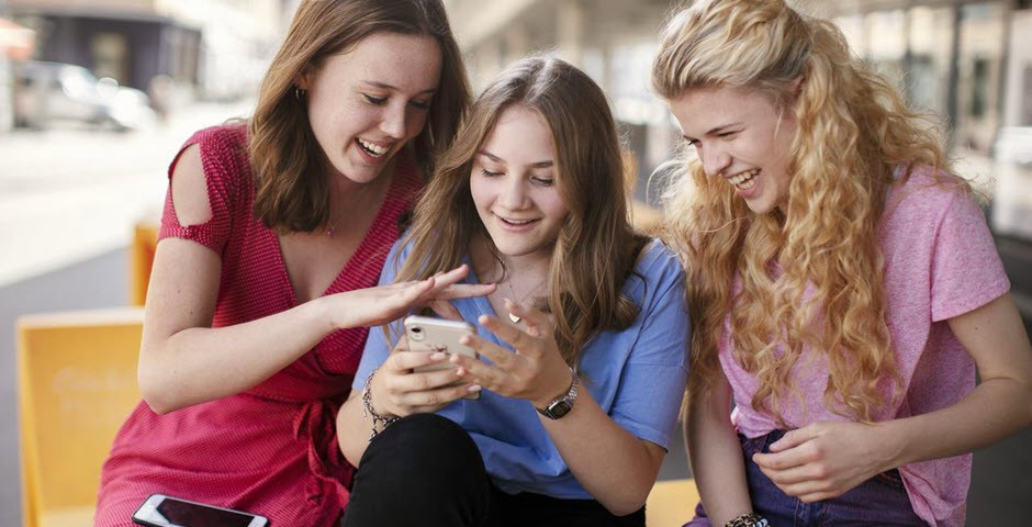 Three girls laugh