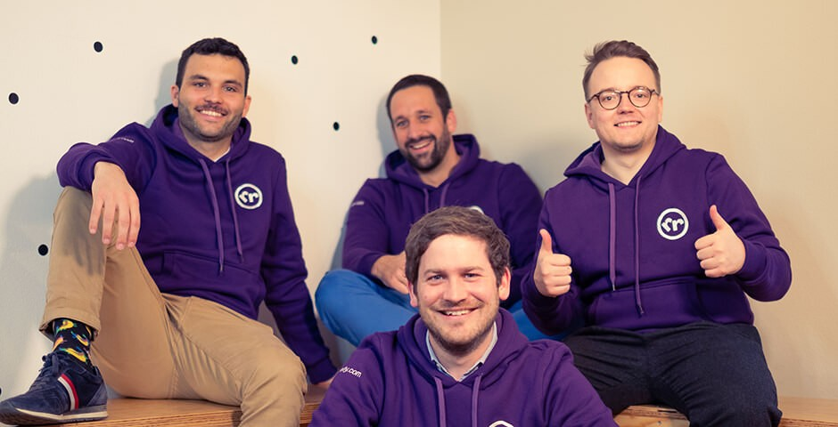 4 men with purple jumpers