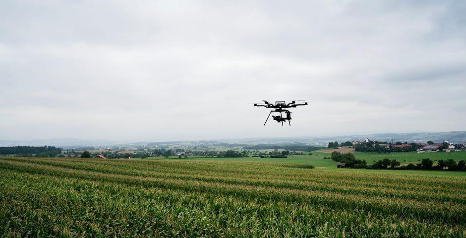 Drone flies over field