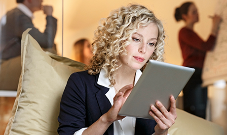 Successful business people with gadgets